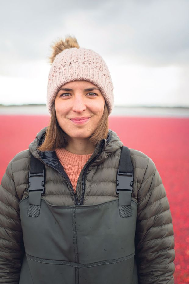 Marie-Michèle Le Moine, Fruit d'Or's retail division director, and brand ambassador for Patience Fruit & Co., with flooded cranberry fields.
