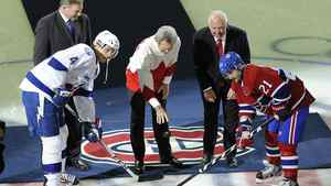 Legendary hockey players, Paul Henderson, centre, Vladislav Tretiak, left, and Yvan Cournoyer, who played in the 1972 Summit Series between Canada and the Soviet Union perform a ceremonnial puck drop for captains of the Montreal Canadiens' Brian Gionta (21) and Tampa Bay Lightning's Vincent Lecavalier (4) in Montreal, Saturday, January 7, 2012. The Habs won 3-1. THE CANADIAN PRESS/Graham Hughes