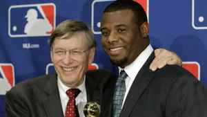 Ken Griffey, Jr, right, poses with Baseball Commissioner Bud Selig after Griffey received the Commissioner's Historic Achievement Award before Game 4 of baseball's World Series between the St. Louis Cardinals and the Texas Rangers Sunday, Oct. 23, 2011, in Arlington, Texas. (AP Photo/Darron Cummings)