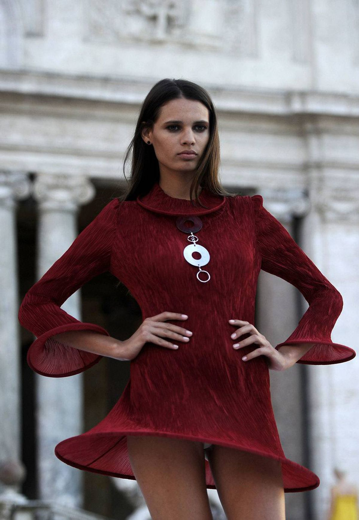 A model displays a creation by French fashion designer Pierre Cardin as he presents his new collection at the French academy in the gardens of Rome's Villa Medici, on June 23, 2011.