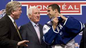 Nazem Kadri of the London Knights shares a laugh with Brian Burke, left, and Cliff Fletcher of the Toronto Maple Leafs as he slips on his jersey at the 2009 NHL entry draft Friday, June 26, 2009 in Montreal.