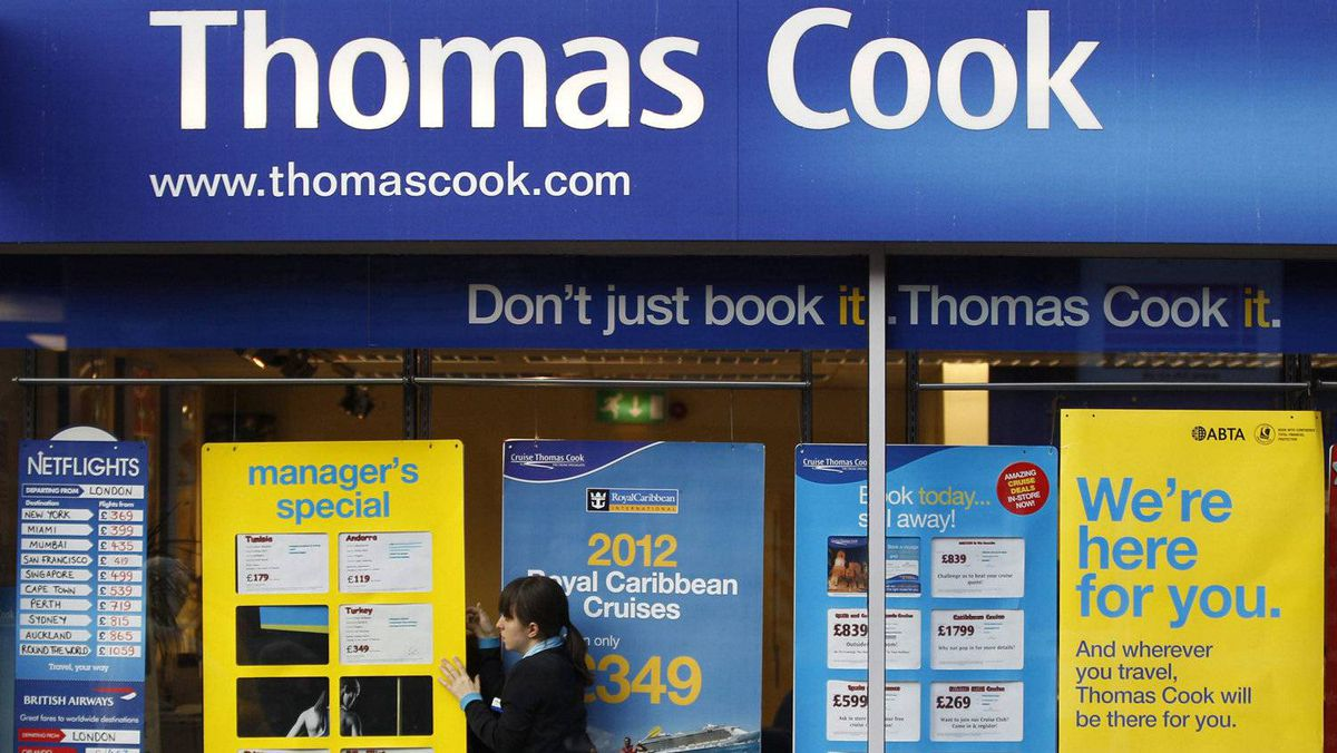 A worker changes the window display of Thomas Cook in Loughborough, central England December 14, 2011.