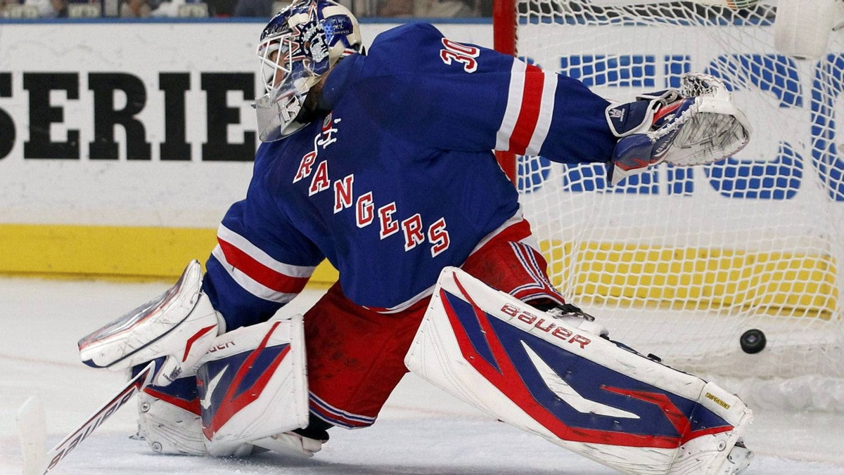 New York Rangers goalie Henrik Lundqvist lets in a goal by New Jersey Devils' Travis Zajac during the first period during Game 5 of the NHL Eastern Conference Finals hockey playoffs at Madison Square Garden in New York, May 23, 2012.