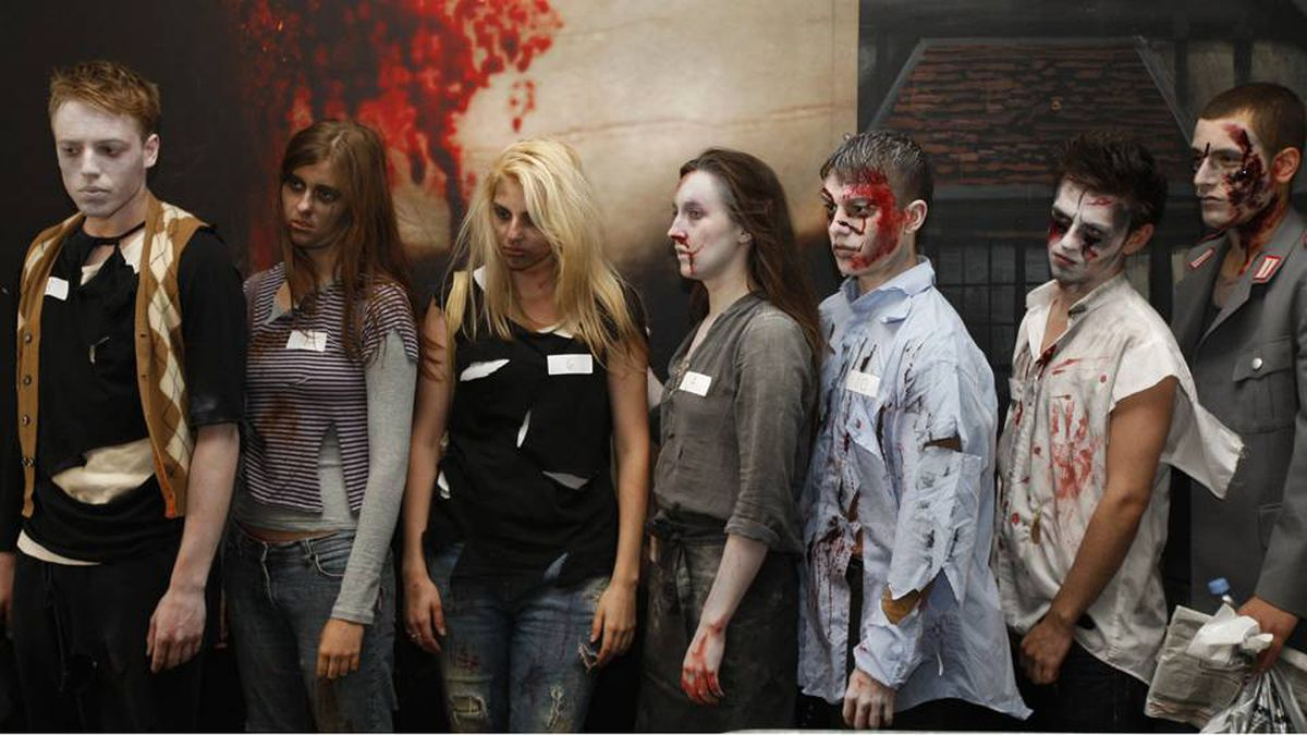 "Candidates queue to audition for the job of ""Zombie"" outside the London Bridge Experience visitor attraction in London July 28, 2009. The successful candidate will have the role of scarring visitors in the tombs underneath the bridge."