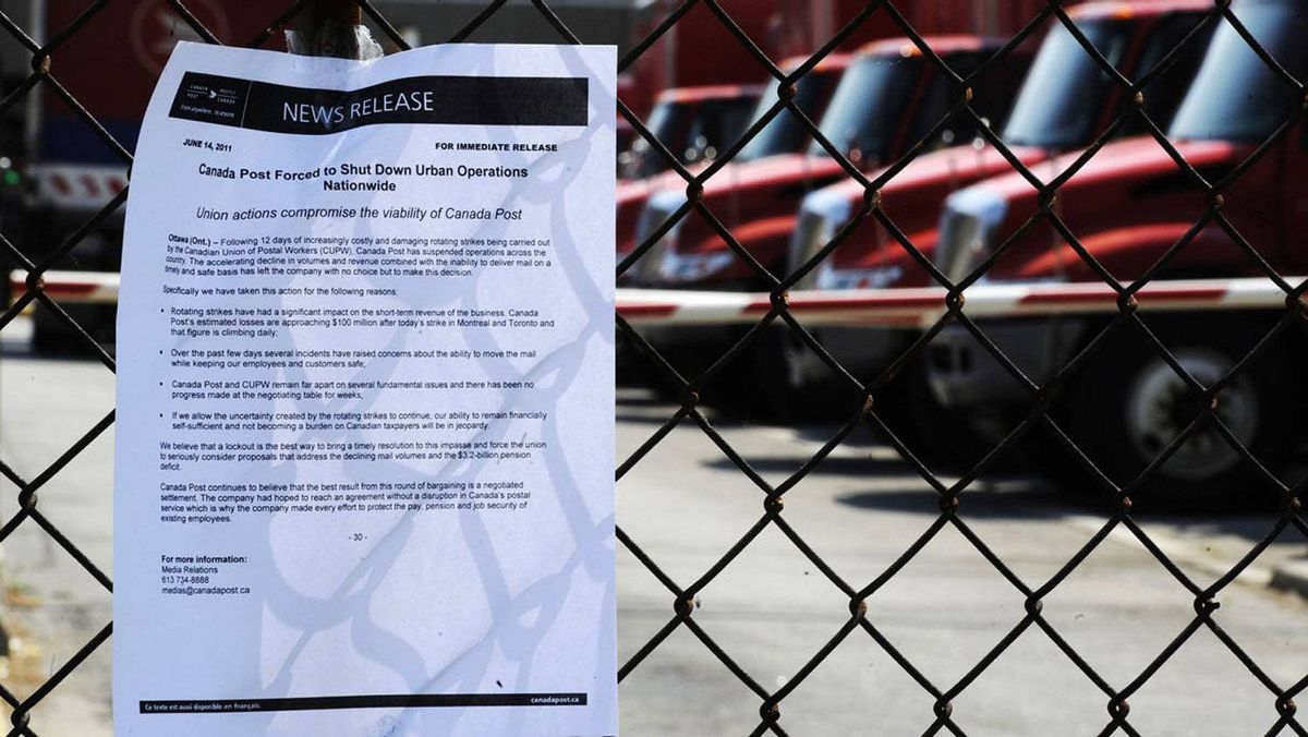 A notice is seen posted on a fence as the Canadian Union of Postal Workers (CUPW) were locked out a Canada Post sorting facility in Toronto, June 15, 2011.