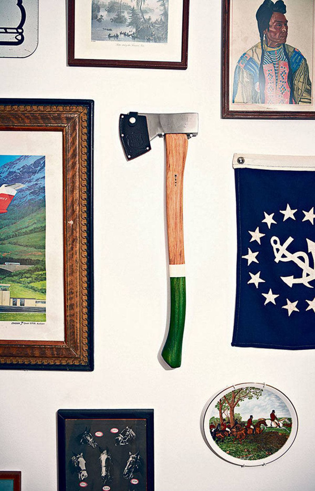 An axe is one of the many flea market finds showcased gallery-style to heighten the haute-rustic vibe.