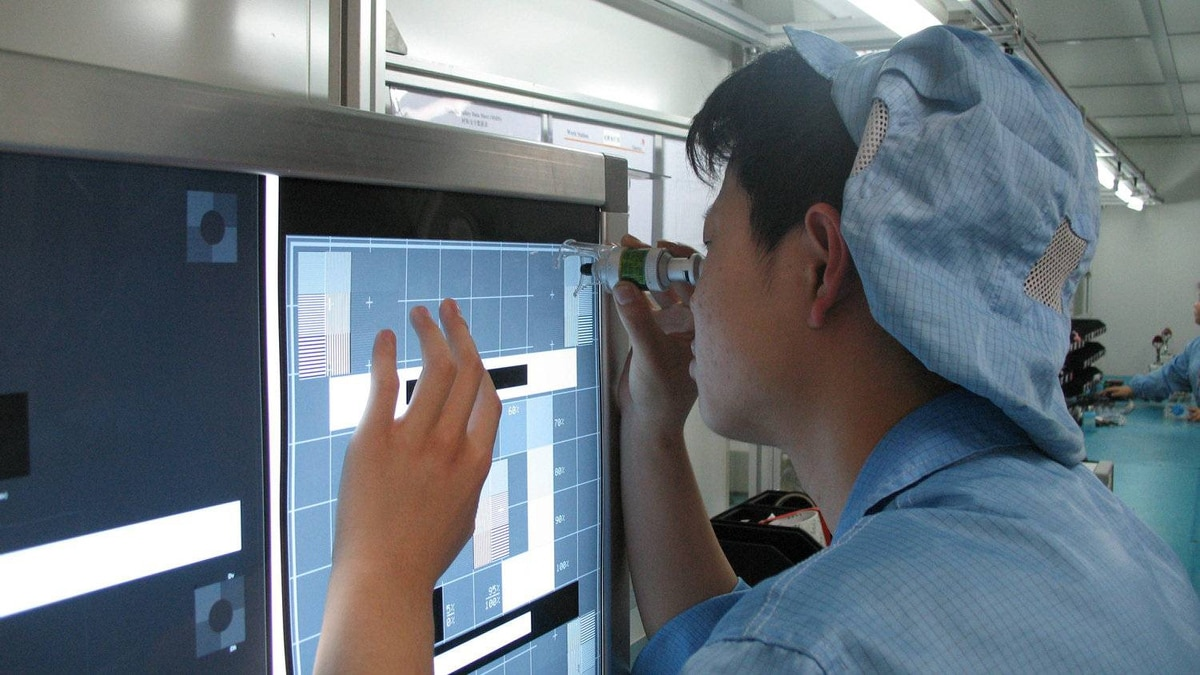 A technician performs quality control at Celestica's plant in Suzhou, China.