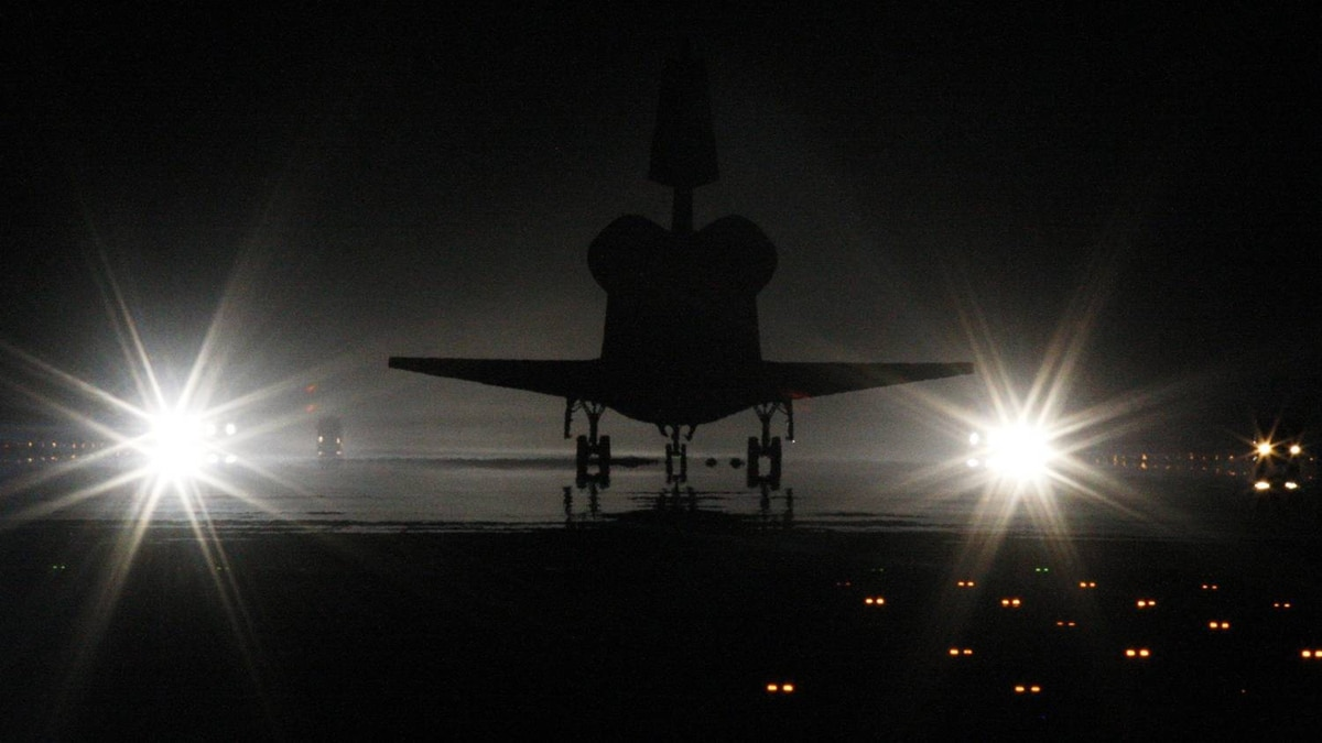 Space shuttle Atlantis lands at the Kennedy Space Center in Cape Canaveral, Florida, July 21, 2011. Atlantis and its four-member crew are back at the space center on Thursday after a mission to resupply the International Space Station, ending a 12-year program to build and service the orbital research outpost.