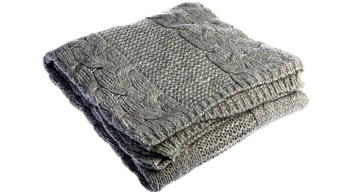 Available in cream, moss and charcoal grey, Indigo's Cozy Cable Throw is designed in-house and made from ultra-soft acrylic – perfect for snuggling up with Heather's latest pick. $69.50.
