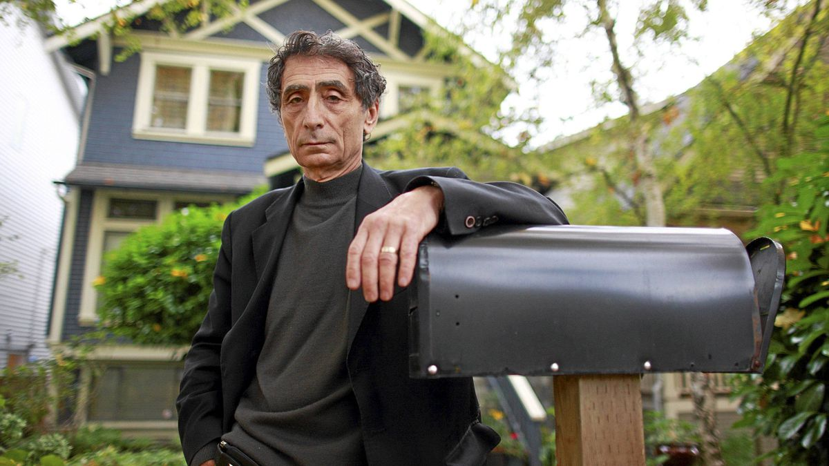 Physician Gabor Mate stands outside his home in Vancouver, Nov. 9, 2011.