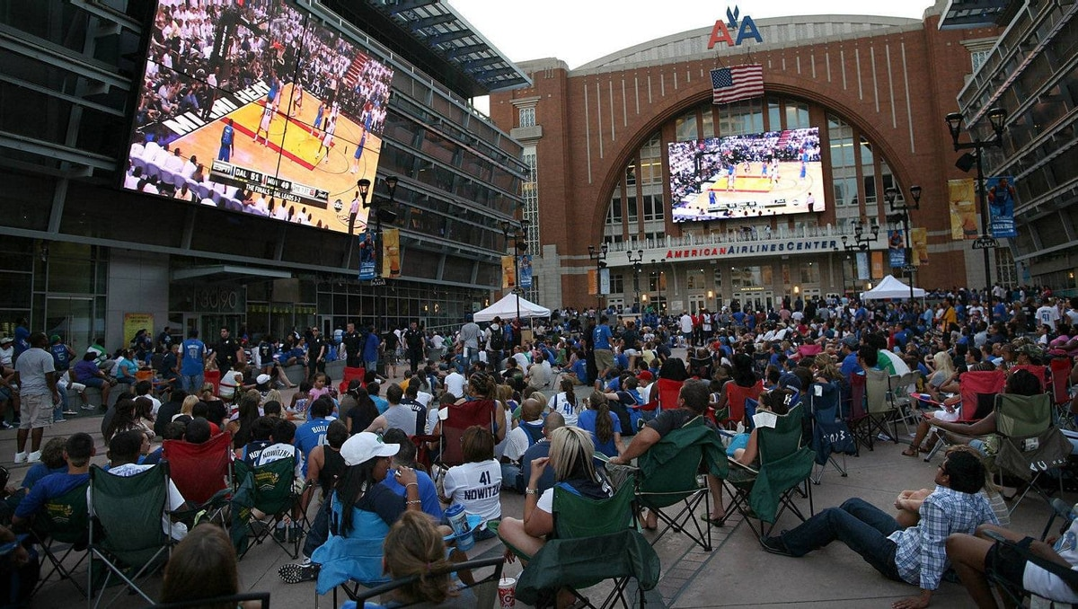 Dallas Mavericks fans cheer on the Mavericks from American Airlines Center during the NBA Finals watch party on June 12, 2011 in Dallas, Texas. (Photo by Tom Pennington/Getty Images)