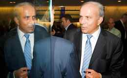 Fairfax Holdings chairman and CEO Prem Watsa chats with shareholders. He received no bonus in 2009 or 2008.