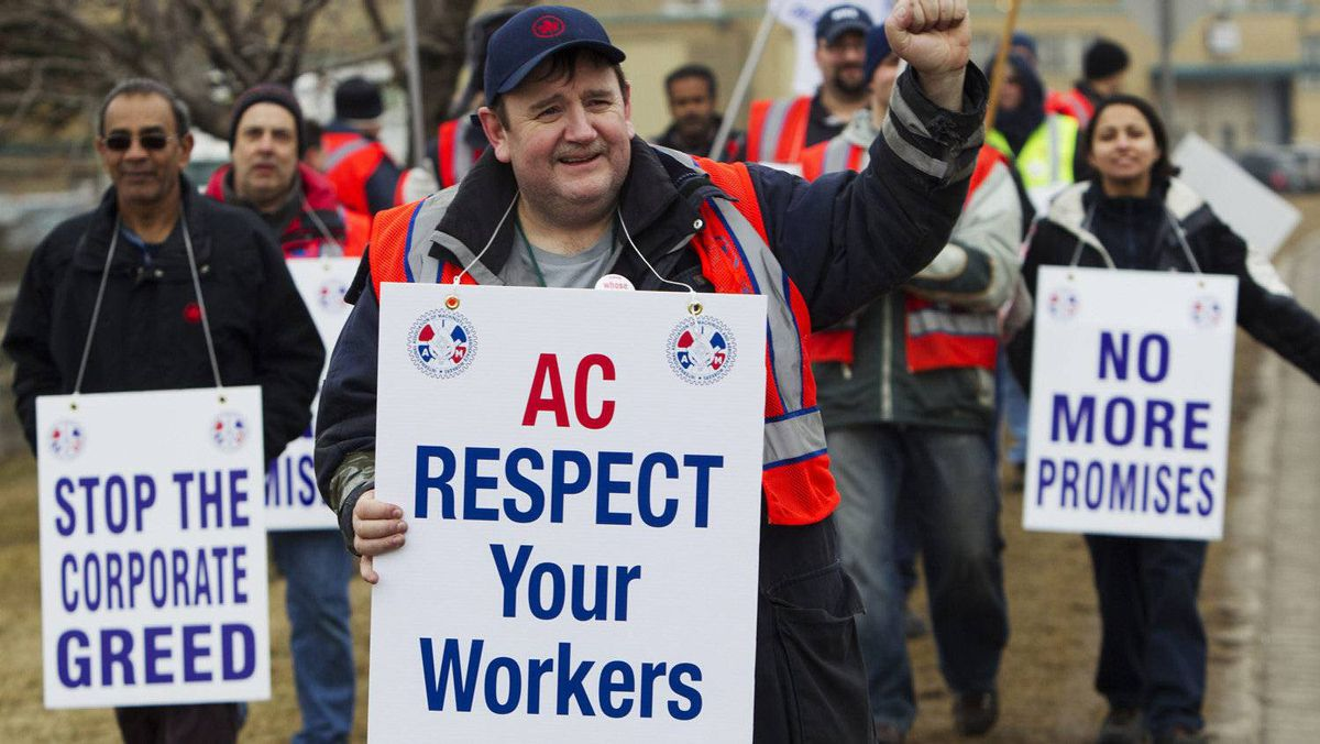 Air Canada mechanics, baggage handlers and cargo agents protest in front of an Air Canada hangar at Pearson Toronto International Airport in Toronto on March 2, 2012.