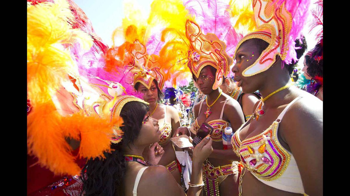 Participants finish their costumes before entering the Caribbean Carnival parade.