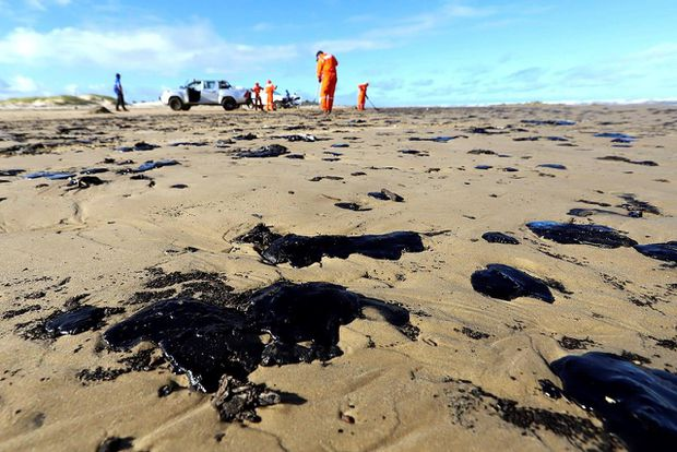 Crude oil reaches tourist beach in the 'Brazilian Caribbean' as the country's largest environmental disaster continues