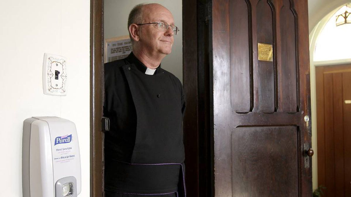 Archdeacon John Bailey in his church the Holy Trinity Cathedral in New Westminster, B.C.