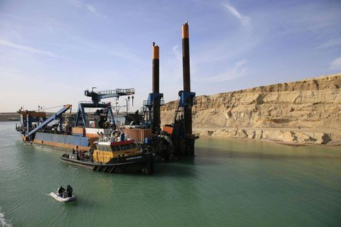 Workers dig round the clock on Suez Canal expansion, hoping for surge in East-West trade
