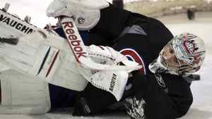 Montreal Canadiens goaltender Carey Price makes a save during the team's practice Tuesday, April 12, 2011 in Brossard, Que. The Canadiens play the Boston Bruins in the first round of the Stanley Cup playoffs Thursday, April 14, 2011 in Boston..THE CANADIAN PRESS/Ryan Remiorz