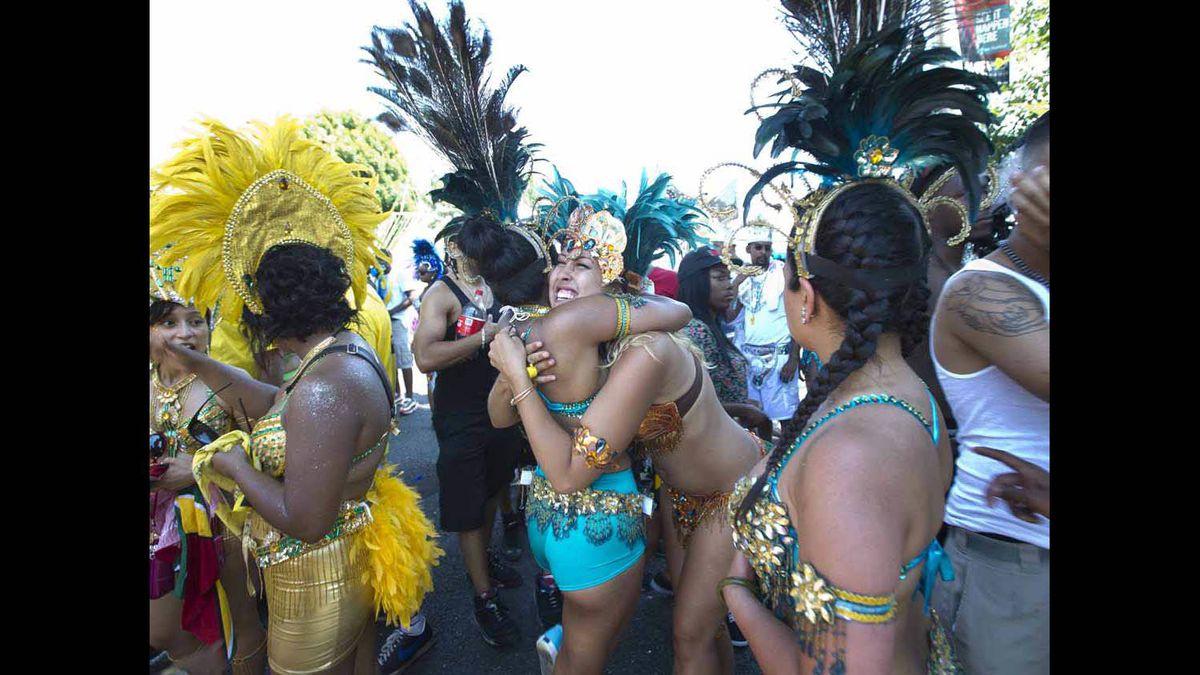 Paraders hug at the Caribbean Carnival in Toronto.
