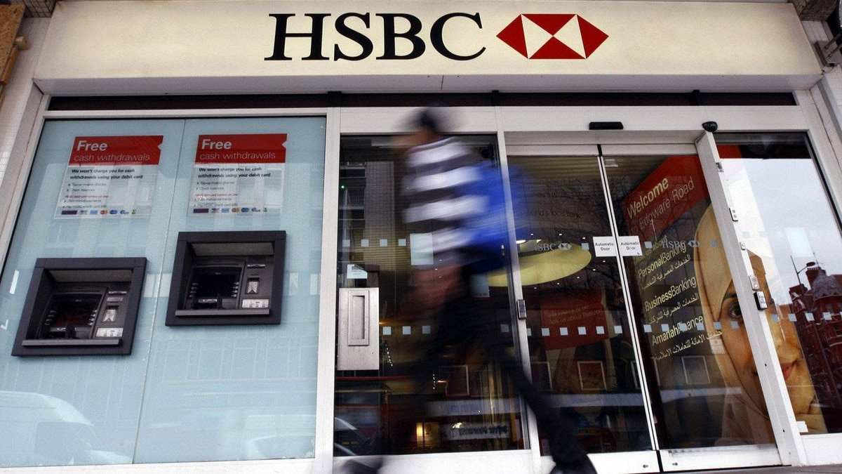 A pedestrian passes a branch of HSBC bank in London, Monday, Feb. 27, 2012.