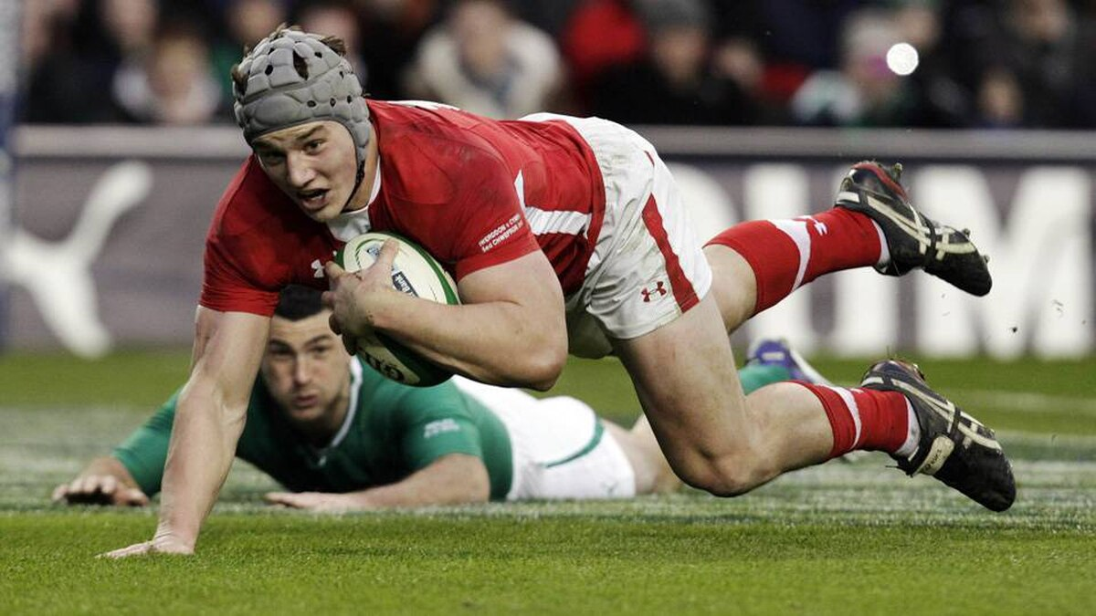 Wales' Jonathan Davies goes over for a try against Ireland during the Six Nations rugby match at Aviva stadium in Dublin on Sunday.