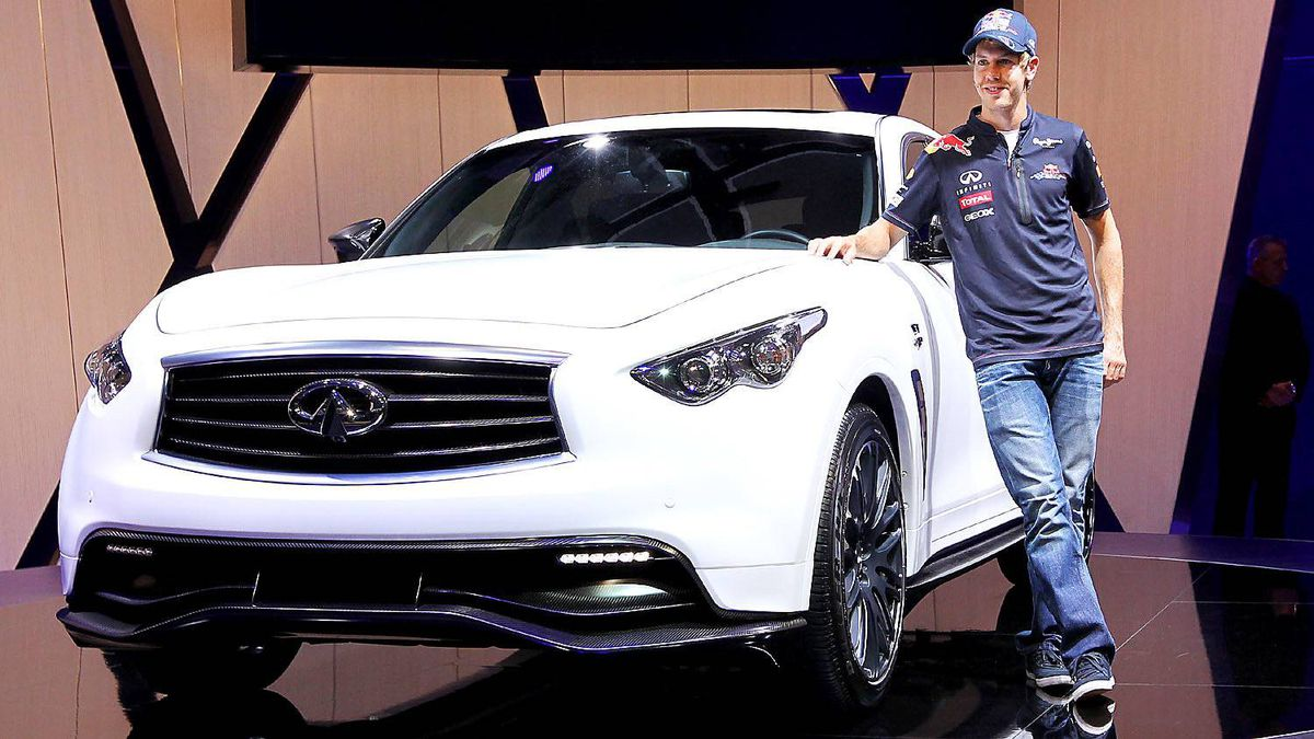 German Formula One World Champion Sebastian Vettel poses next to the new Infiniti FX Sebastian Vettel Edition