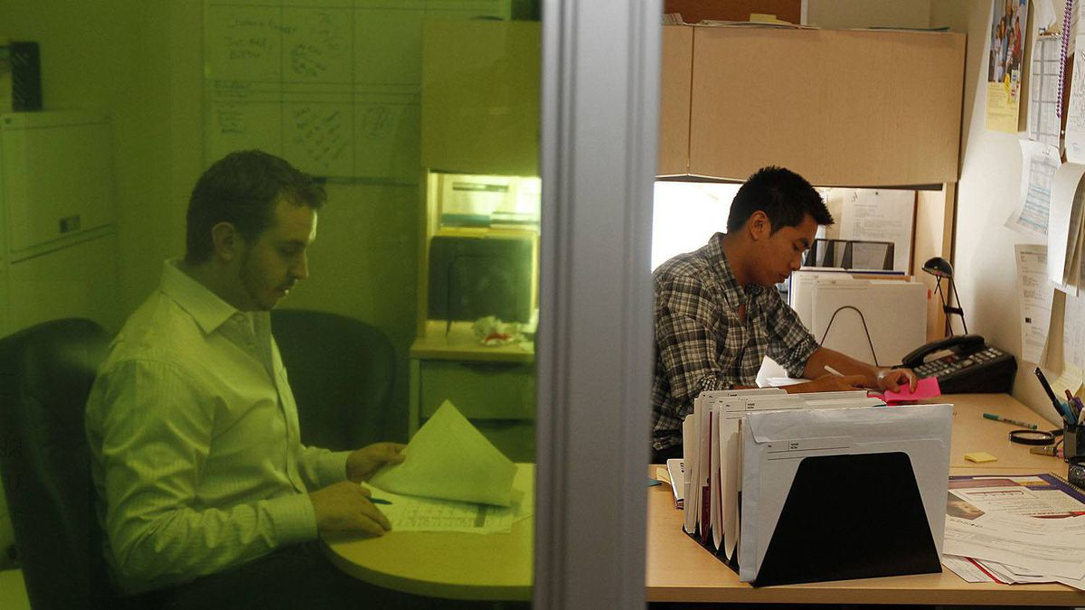 Daniel Dolan (L) and Jonathan Nguyen, who have taken unpaid internships to gain experience over the summer, are photographed at their workplace in downtown Toronto July 14 2011.