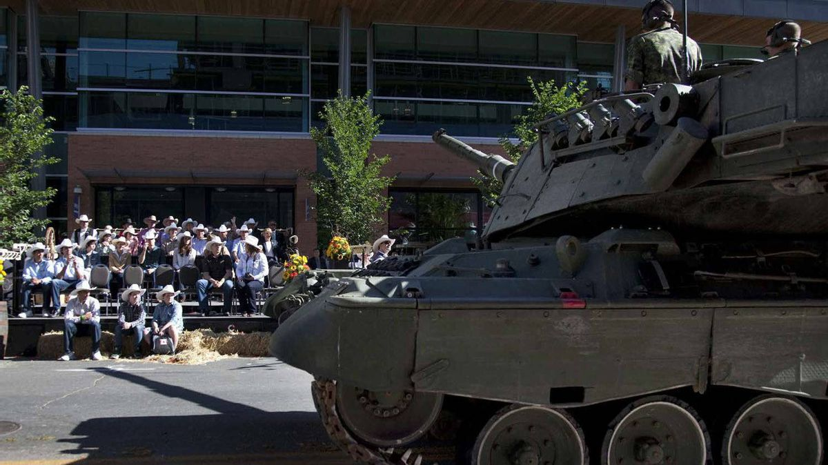 A Canadian military tank points its gun towards The Duke and Duchess of Cambridge during the stampede parade in Calgary, Friday, July 8, 2011.