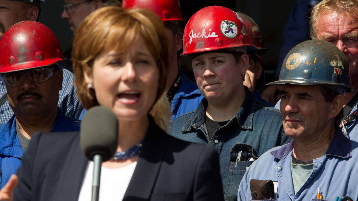 Seaspan Shipyards workers listen as British Columbia Premier Christy Clark speaks at the shipyard in North Vancouver, B.C., on Tuesday June 7, 2011.