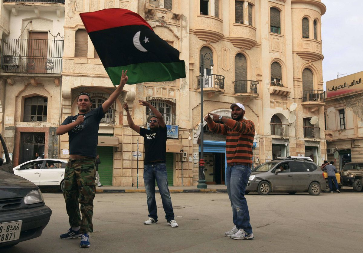 Libyans celebrate after news of Saif al-Islam Gaddafi's arrest, near the courthouse in Benghazi November 19, 2011.