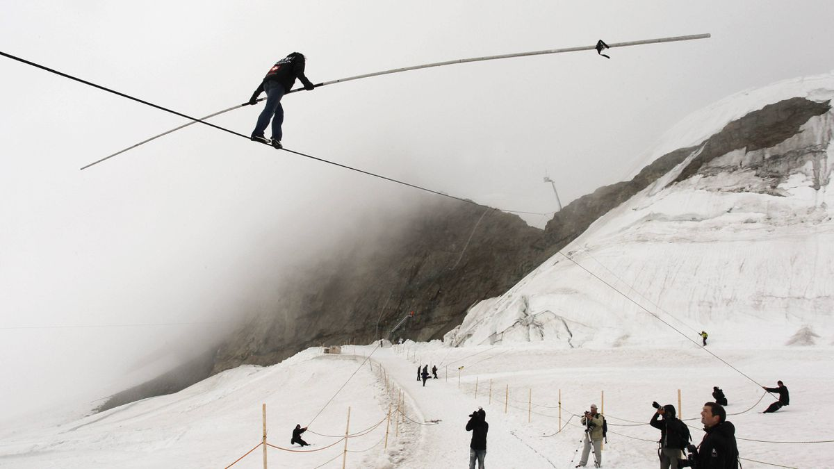 Swiss acrobat Freddy Nock balances upon a rope at the Jungfraujoch (3454 metres) in Bernese Oberland August 26, 2011.
