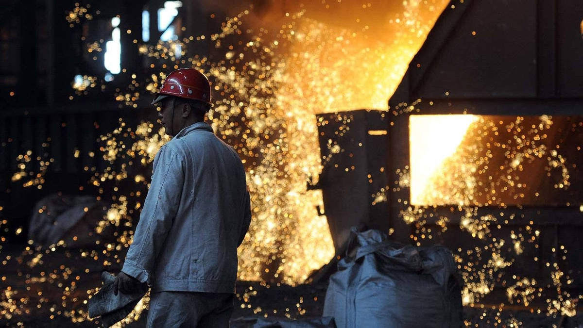 On June 25, 2011 employees working beside a giant cauldron at a steel mill in Hefei, in eastern China's Anhui province. Growth in China's manufacturing activity fell to an 11-month low in June, preliminary HSBC data released on June 23 showed, as Beijing's efforts to cool the red-hot economy continued to bite.