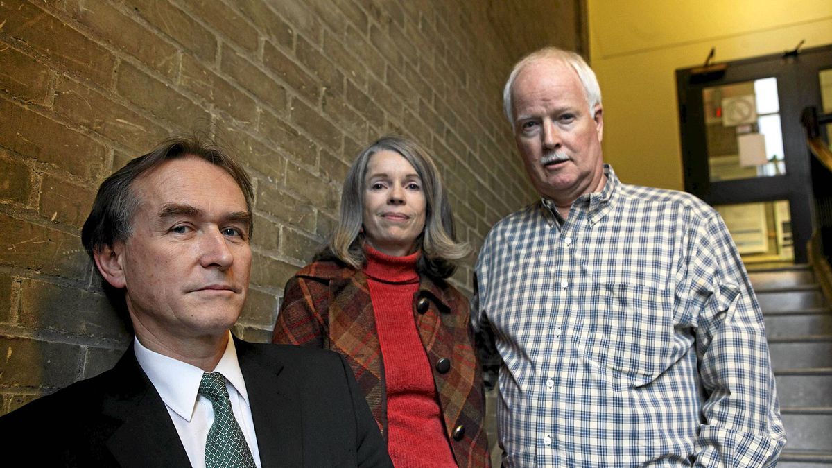 David Healy, a psychiatrist and critic of the drug industry stands with Julie and Peter Wood in Toronto.