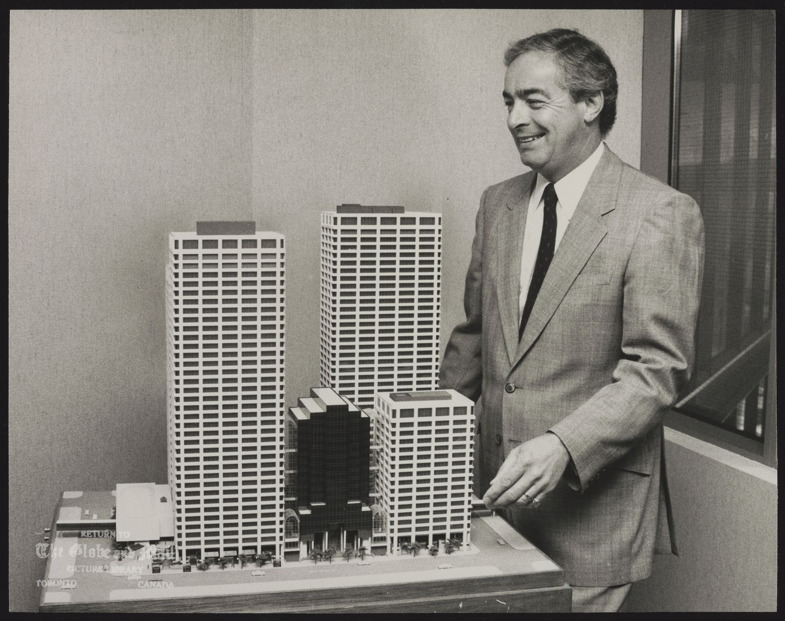 Bruce HEYLAND Toronto. Businessman Bruce Heyland with a model of Hammerson's 125-million Bow Valley Square office-retail complex in Calgary.