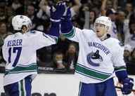Vancouver Canucks Christian Ehrhoff (R) celebrates with Ryan Kesler after scoring against the Los Angeles Kings during the second period of Game 4 of their NHL Western Conference quarter-final hockey game in Los Angeles, April 21, 2010.