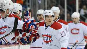 Montreal Canadiens left wing Mike Cammalleri celebrates scoring a goal with his teammates in the first period of an NHL hockey game against the Colorado Avalanche in Denver on Sunday, Dec. 19, 2010. The Avs won 3-2. (AP Photo/Chris Schneider)