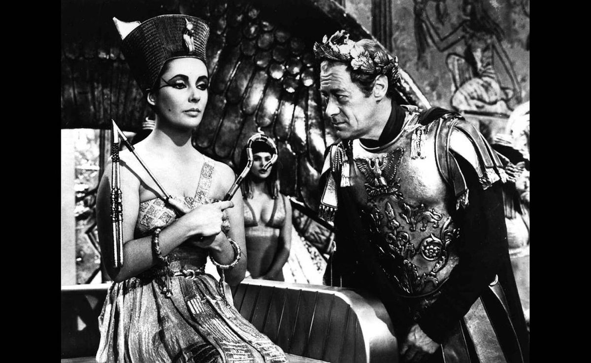 Elizabeth Taylor and Rex Harrison appear in a scene from the 1961 film Cleopatra.