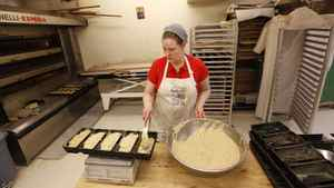 Sweets baker Stephanie Smith at St. John's Bakery. The bakery gives people a chance at steady employment, like Ms. Smith, a mother of three who had to go back to school and spent months looking for work before getting a job at the organic bakery.