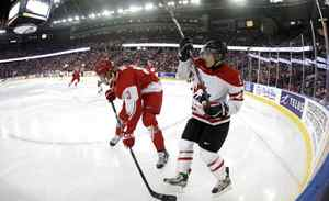 Canada's Brendan Gallagher and Denmark's Mathias Bau Hansen battle in the corner during the third period of play at the 2012 IIHF U20 World Junior Hockey Championships in Edmonton, Alberta, December 29, 2011.