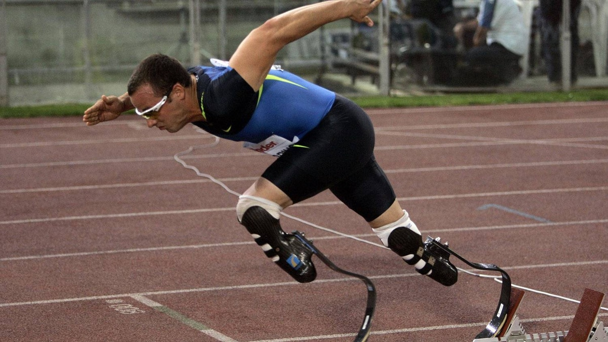 """Oscar Pistorius is seen at the start of the men's 400 meters race in Rome's Olympic stadium, Friday, July 11, 2008. The South African double amputee, who runs on carbon-fiber blades, is looking to make history by becoming the first amputee runner to compete in an Olympics. The """"Blade Runner"""" has already gone under the 400-meter Olympic qualifying time of 45.30 seconds and needs to do it once more at an international meet to be eligible for Olympic selection. Pistorius also plans to run in able-bodied IAAF events in Europe and the U.S. ahead of the Olympics. He'll compete in the Paralympics, too."""