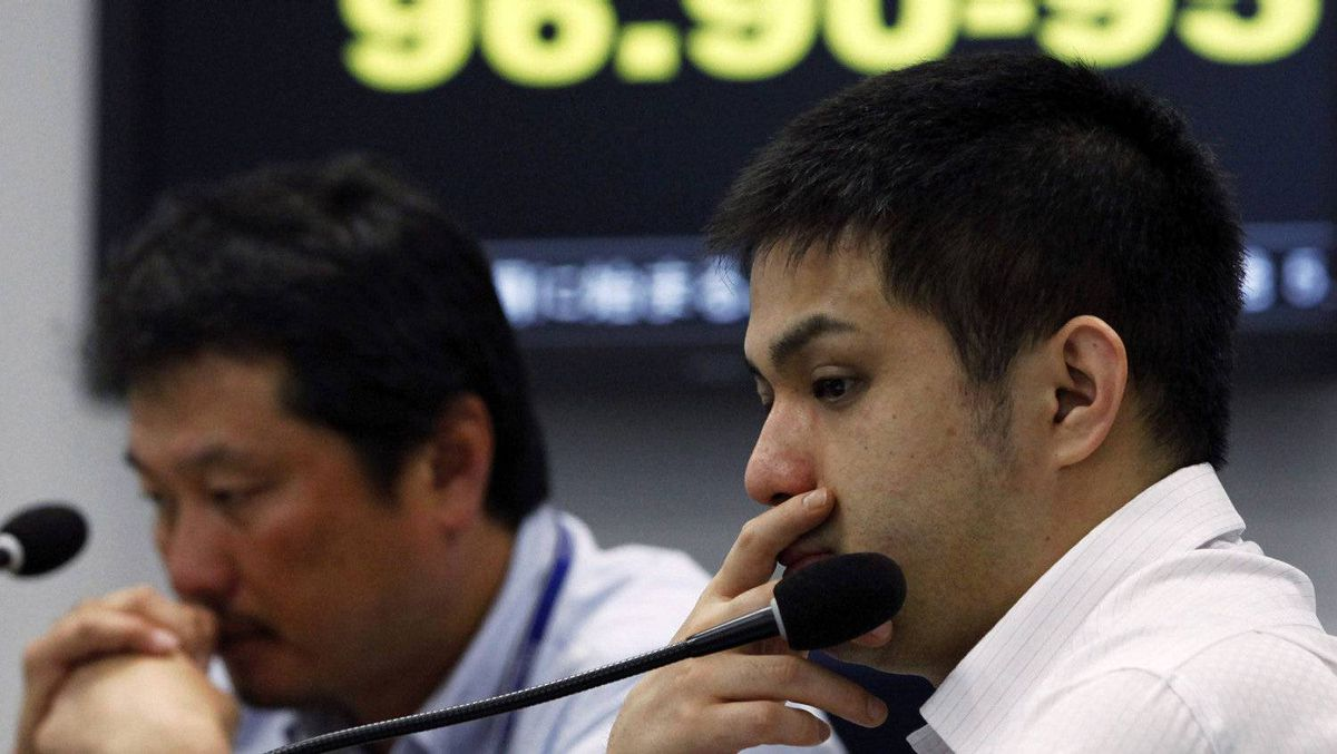Foreign exchange brokers sit in front of an electronic board displaying the Japanese yen's exchange rate against the euro at a trading room in Tokyo on Friday.