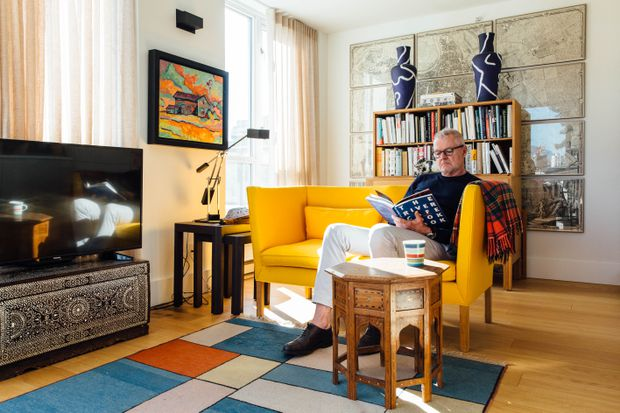 Robert Lemon Reads A Book In The Sunlit Morning Room His Vancouver Condo On March 29 2019