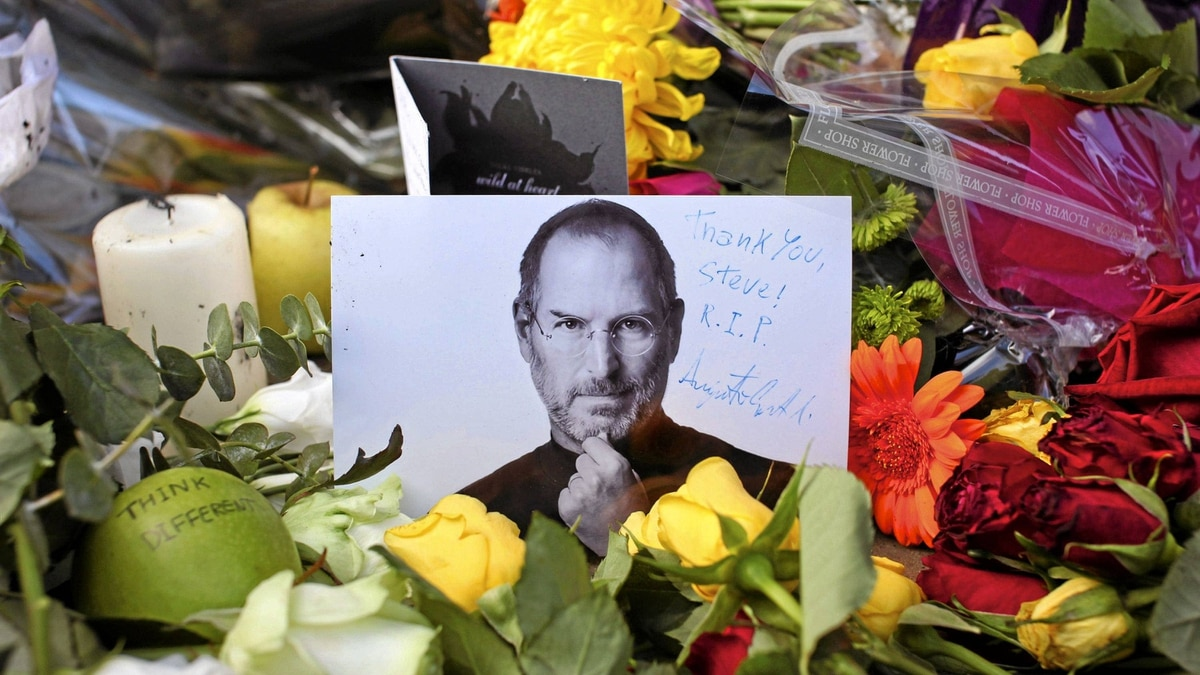 Tributes surround a memorial photograph of the late Steve Jobs outside the Apple Store on Regent Street in London on Oct. 6.