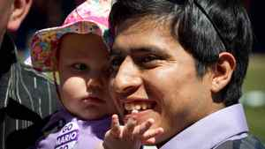 "Ten-month-old Caitlynn Flasha, left, reaches for Kentucky Derby winning jockey Mario Gutierrez, of Mexico, while being held by her father, Tavis, at Hastings Racecourse in Vancouver, B.C., on Sunday May 13, 2012. Gutierrez, who rode ""I'll Have Another"" to victory in last week's Kentucky Derby met with fans at Hastings where he began his career before moving to the U.S. THE CANADIAN PRESS/Darryl Dyck"