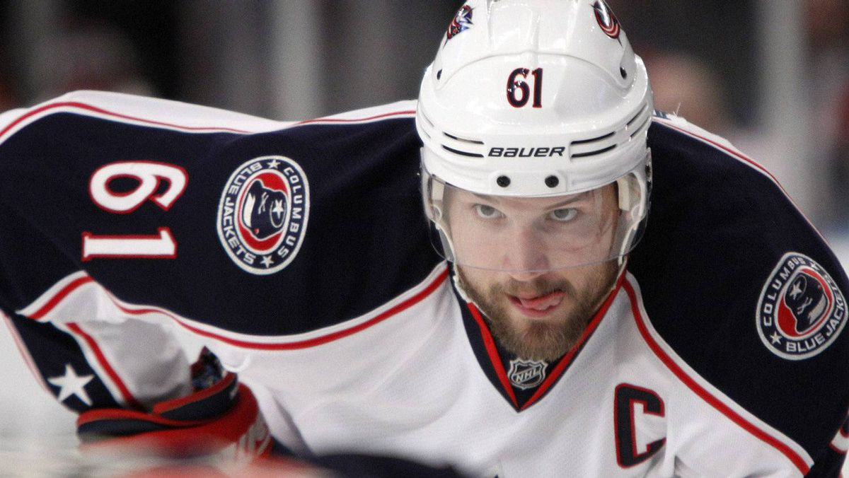 In this Feb. 19, 2012, file photo, Columbus Blue Jackets' Rick Nash (61) watches a face off during the third period of an NHL hockey game against the New York Rangers at New York's Madison Square Garden. The NHL trade deadline is Monday and contenders have to decide if they want to risk the future to win now. Columbus captain Rick Nash is available and it seems every team is in talks with the Blue Jackets about acquiring the star.(AP Photo/Kathy Willens, File)