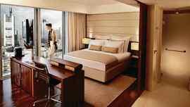 Floor-to-ceiling windows make it easy to enjoy the Frankfurt skyline.