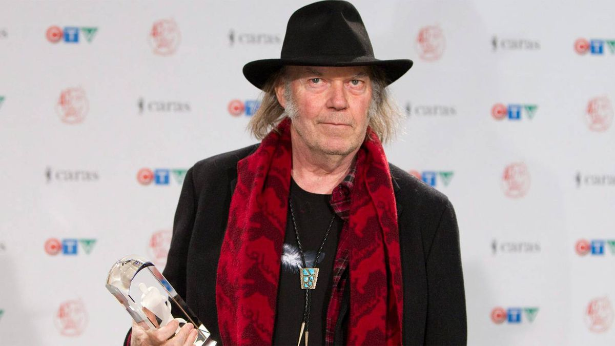 Neil Young poses with his Juno award for Adult Alternative Album of the Year at the 2011 Juno gala dinner and awards show in Toronto Saturday, March 26, 2011.