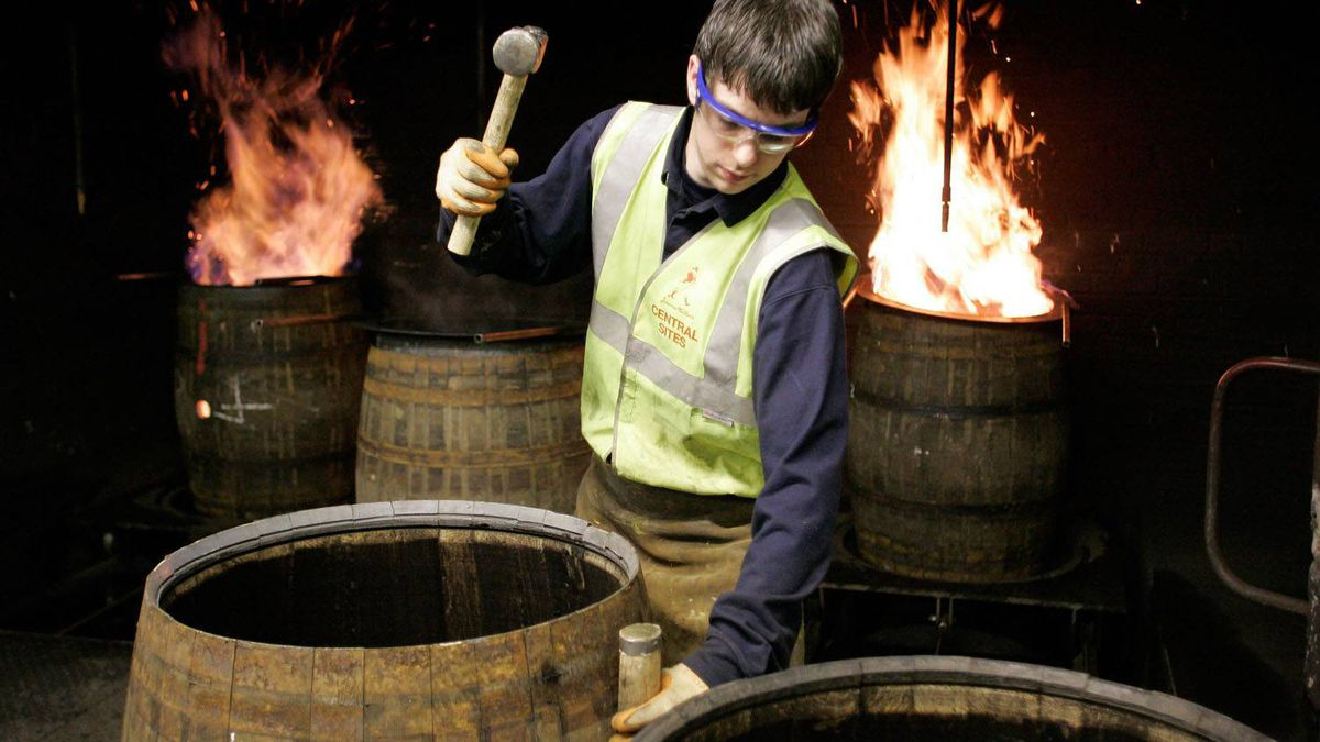 A cooper rebuilds oak casks at the company's traditional cooperage at Carsebridge, Scotland. The casks, recycled from previous use, will be used to store Diageo's scotch whisky.