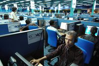 Photo taken on October 30, 2007 shows Filipino call center personnel attending to their US clients at a new business process outsourcing office in Manila.