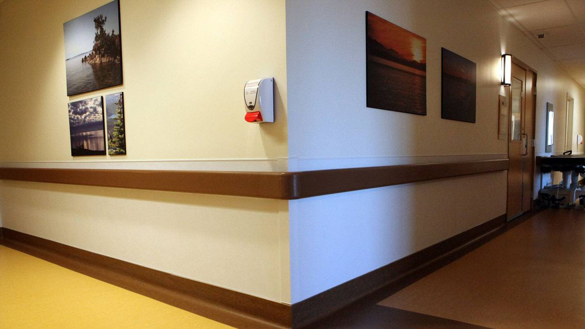 Bright wide open hallways, artwork, soft contrasting colours, wood accents at the Patient Care Centre in the Royal Jubilee Hospital provide elderly patients a much better stay in Victoria, B.C.